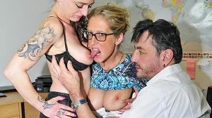 Jana L. & Adrienne Kiss – Tattooed German sluts in their 40s go for swinger sex in FFM threesome