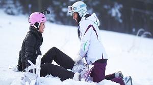 Cayla Lyons & Terra Twain – Snowboard student and older woman